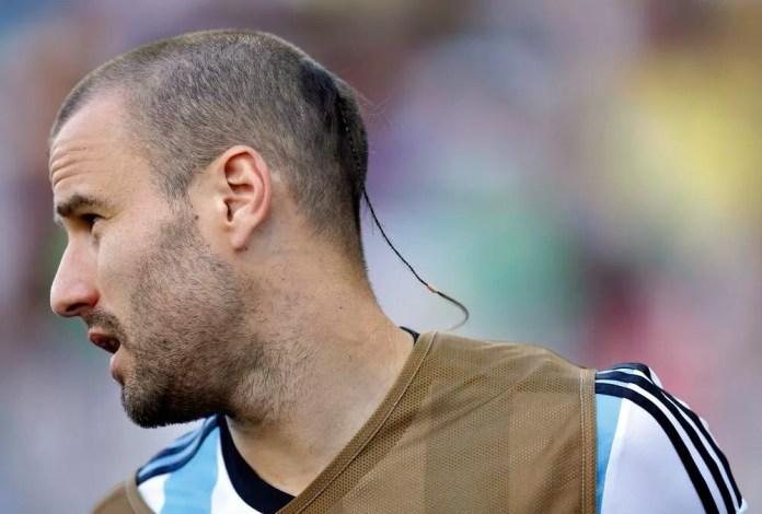 Футболист с косичкой фото