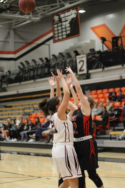 Senior Haley Lowe attempts to block a Grace Brethren player from making a basket. Credit: Sarah Kagan/The Foothill Dragon Press
