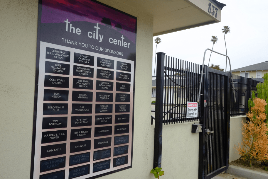 The front gate displays the names of sponsors who help to keep the transitional living community running. Credit: Grayson McCoy / The Foothill Dragon Press