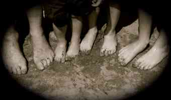 The feet of the men in my family nestled in the sand of a New York beach