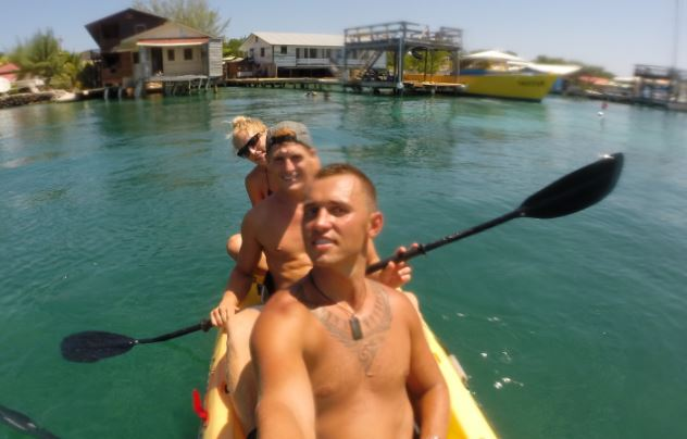Paddling away from Utila towards our catamaran..  Goodbye for now..!