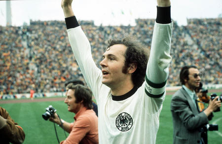 1974 World Cup Final. Munich, West Germany. 7th July, 1974. West Germany 2 v Holland 1. West German captain Franz Beckenbauer raises his arms in celebration as they become World Champions for the second time in history.