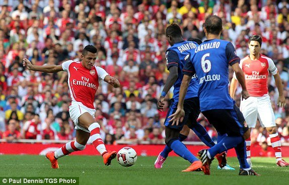 1407080722100_lc_galleryImage_Arsenal_s_Alexis_Sanchez_