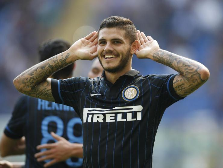 Inter Milan forward Mauro Icardi, of Argentina, celebrates after scoring during a Serie A soccer match between Inter Milan and Sassuolo, at the San Siro stadium in Milan, Italy, Sunday, Sept.14, 2014. (AP Photo/Luca Bruno)