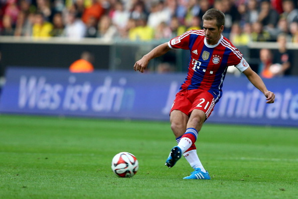 DORTMUND, GERMANY - AUGUST 13: Philipp Lahm of Bayern Muenchen runs with the ball during the DFL Supercup match between Borussia Dortmund and FC Bayern Muenchen at Signal Iduna Park on August 13, 2014 in Dortmund, Germany.  (Photo by Christof Koepsel/Bongarts/Getty Images)