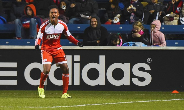 Oct 3, 2015; Chicago, IL, USA; New England Revolution forward Juan Agudelo (17) reacts after making a goal against the Chicago Fire  during the first half at Toyota Park. Mandatory Credit: Mike DiNovo-USA TODAY Sports