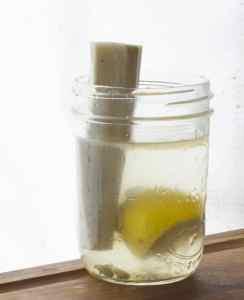 burdock being dipped in lemon water