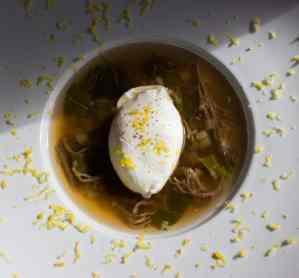 coral mushroom soup with truffle salt cured egg yolk