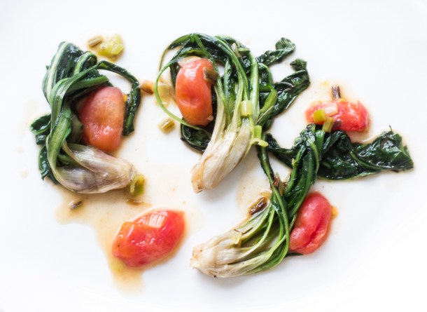 Young dandelions with green garlic and grape tomatoes