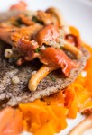 Buckwheat crusted sole with red chanterelle pan sauce and carrot ribbons