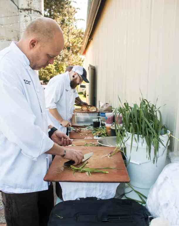Salt Cellar Team Prepping Green Garlic
