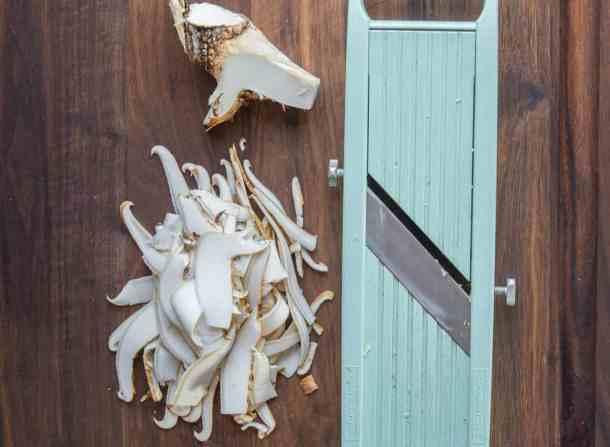 Shaving dryad saddle or pheasant back mushrooms on a mandoline