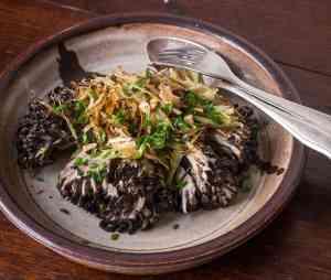 Roast hen of the woods mushroom with leeks and black walnuts