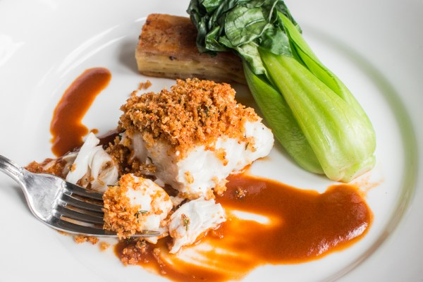 Skrei cod baked with lobster mushroom breadcrumbs, lobster sauce, potato pave and bok choy