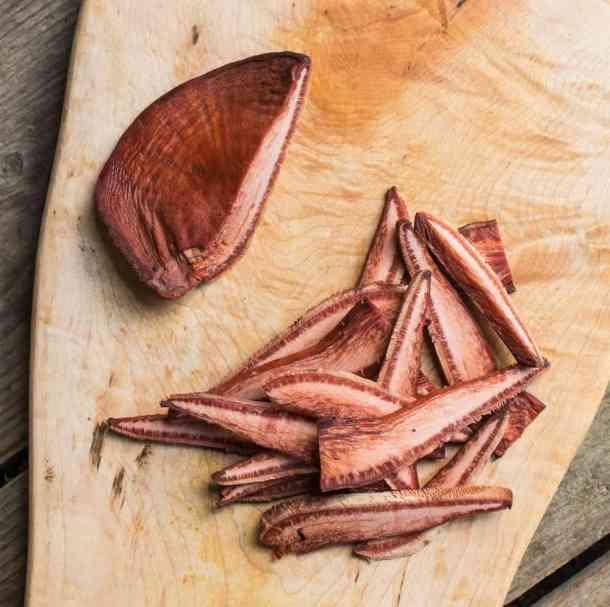 Cutting up beefsteak or Fistulina hepatica mushrooms