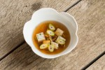 Lactifluus volemus mushroom broth with shrimp mousseline dumplings