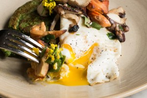 Stinging nettle pancakes recipe with pheasant back mushrooms and venison bacon