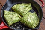 Baked crepes stuffed with nettles