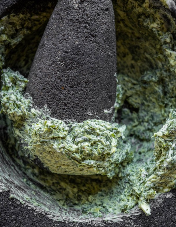 Making wild chervil butter in a mortar and pestle