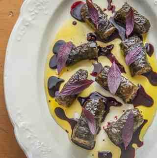 Mushroom and walnut sarmasi with black walnuts and wild grape juice