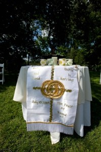 A family friend, Charlotte, sewed this beautiful hanging for us. We used it on a small table displaying our unity candles and remembrance candle.