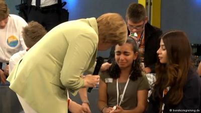 Mrs Merkel and refugee child