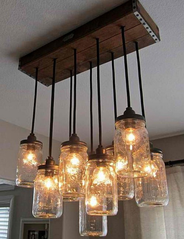 DIY Mason Jar Chandelier: DIY your own unique rustic chandelier using mason jars! It will make a great addition and add that warm glam to any home.