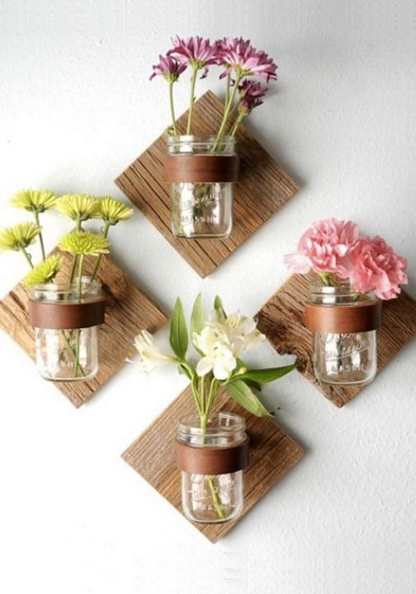 DIY Rustic Mason Jar Sconce: Brighten your home with these wall mounted mason jar vases this spring!