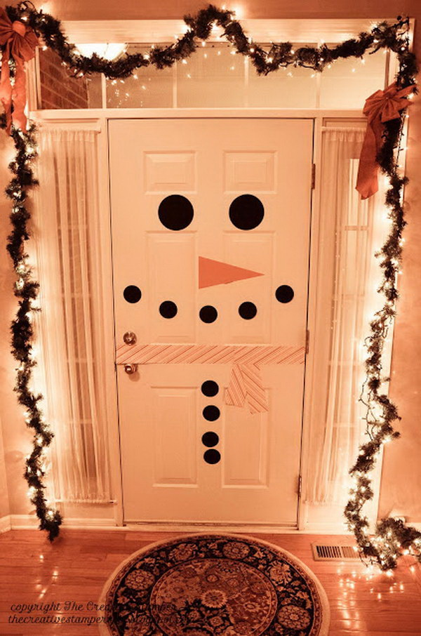 Snowman Door Decoration. Decorate your door with this creative and simple idea. You kids will in LOVE with this snowman project!