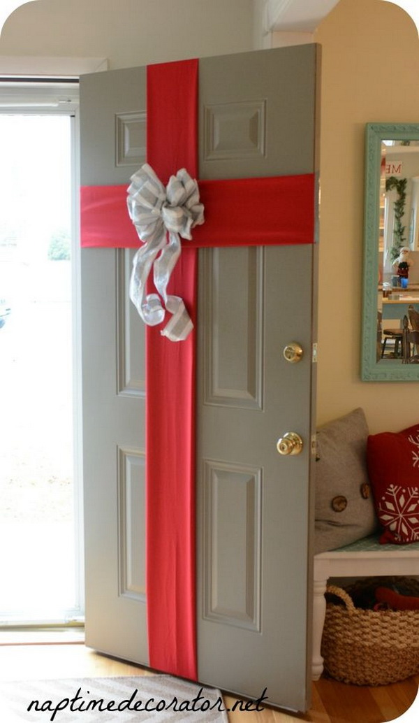 Gift Wrapped Front Door for Christmas. Gift-wrapping the front door is a traditional way to get your home festive ready for the holidays. Look at this one, it will surely make a lasting impression for your new homeowners this holiday season.