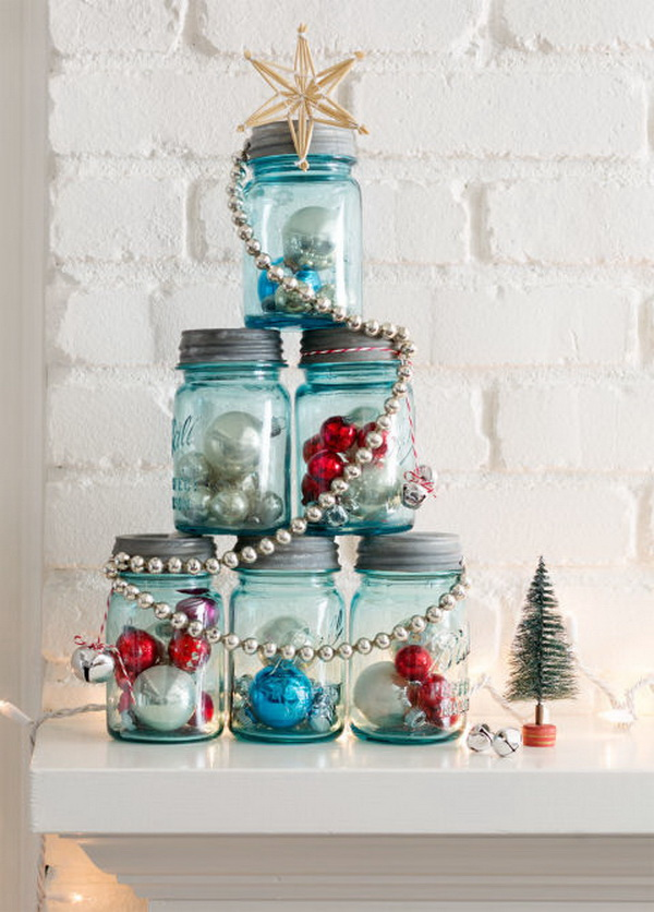Mason Jar Christmas Tree. Fill six mason jars of the same size with ornaments, tinsel, greenery. Assemble the jars in a pyramid, then wrap it with a shiny garland and top with a star. Perfect for a mantel or entry table decorating this Christmas.