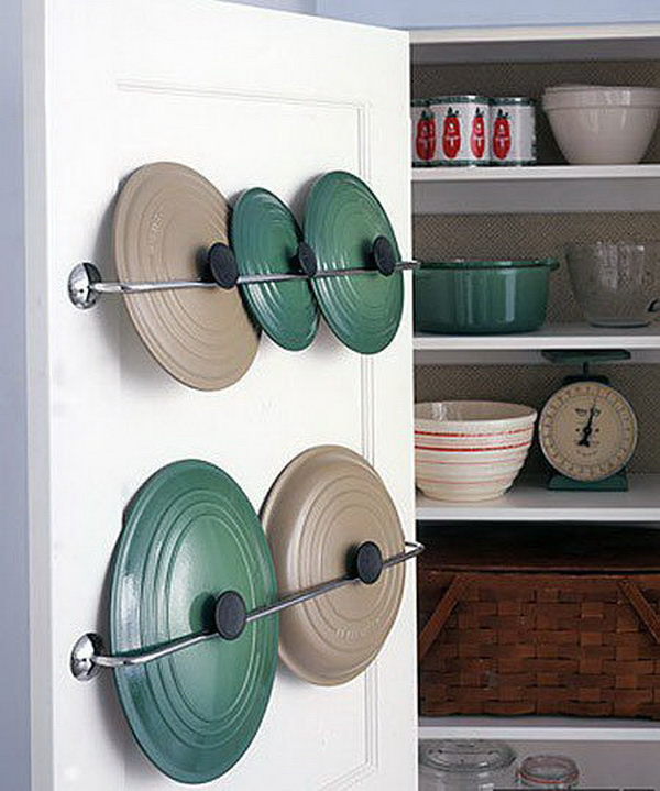 Simple Kitchen Hack: Pot Lids Storage Solution: Clever idea of storing the pot lids on the inside of the cabinet door using towel racks and gravity. It's a great way to save some space for the pots themselves!