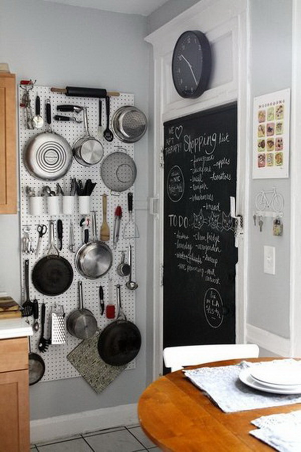 Vertical Storage and Chalkboard Wall: Hang pots and pans from a vertical pegboard for space saving and paint a wall in chalk paint for an easily accessible shopping list that won't clutter your fridge.