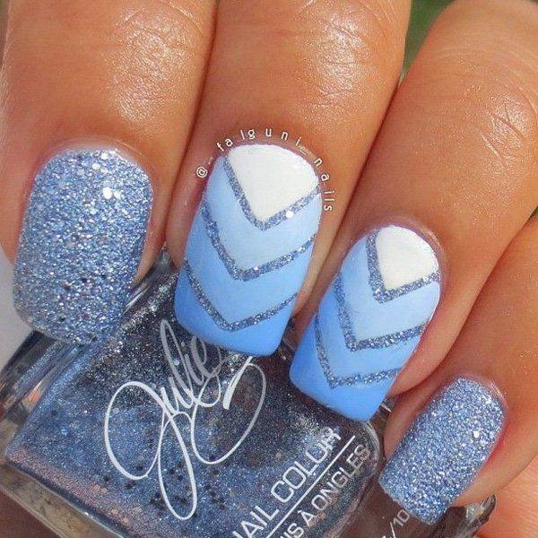 Blue Glitter Nail Art Design with V-shaped Details.