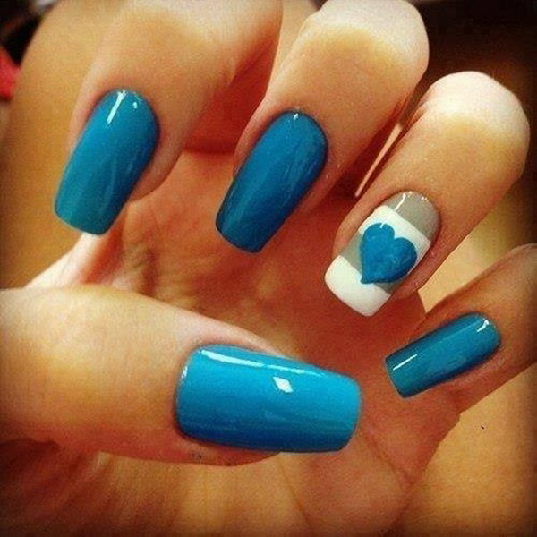 Blue and White Heart Nail Design.