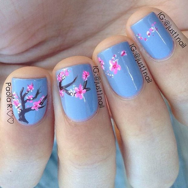 Blue Background and Cherry Blossom Nail Design.