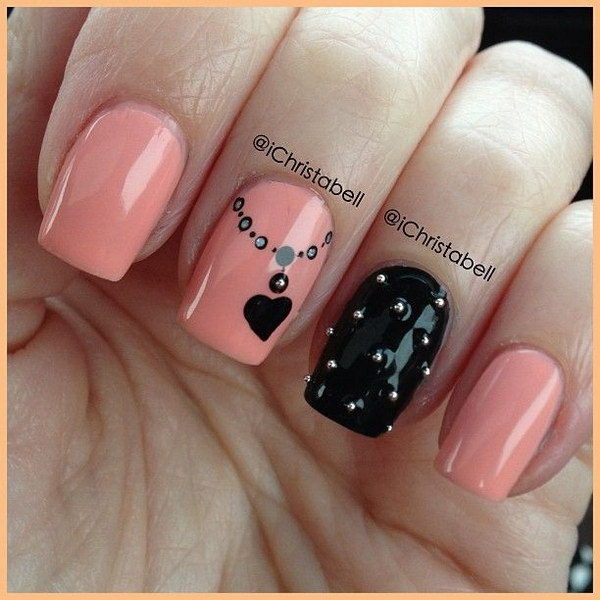 Coral and Black Nails with a Heart Necklace Pendant Detail.