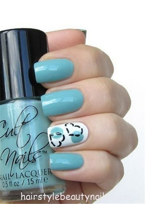 Baby Blue Nails with Hearts Accented.