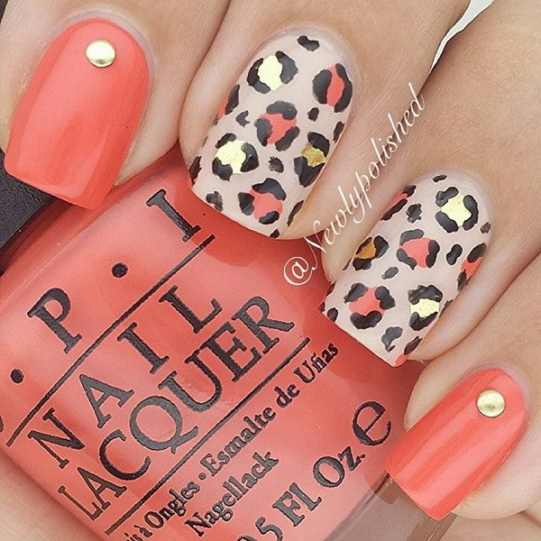 Leopard or Cheetah Nails with Studs. This nail design is using coral and nude polish as base coating and adds some gold, black and coral prints on top.
