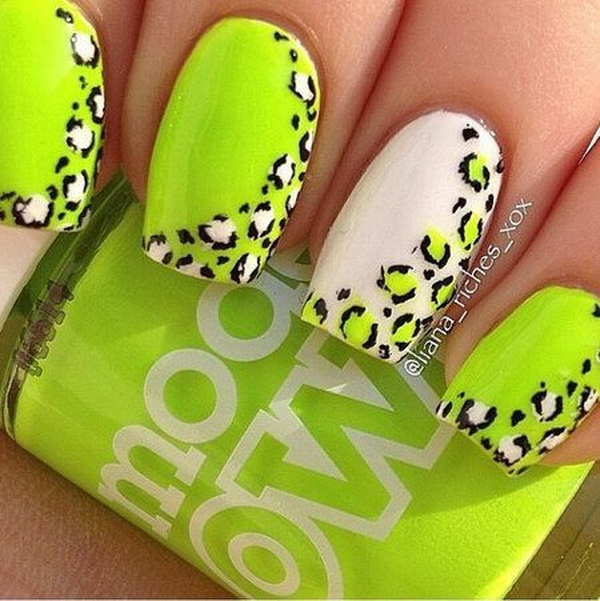 Nail art with neon green and white in cheetah design.