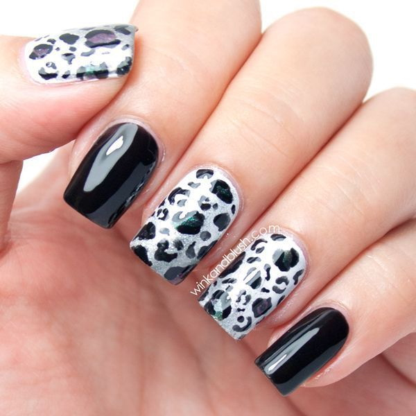 Black and white nail with leopard prints.