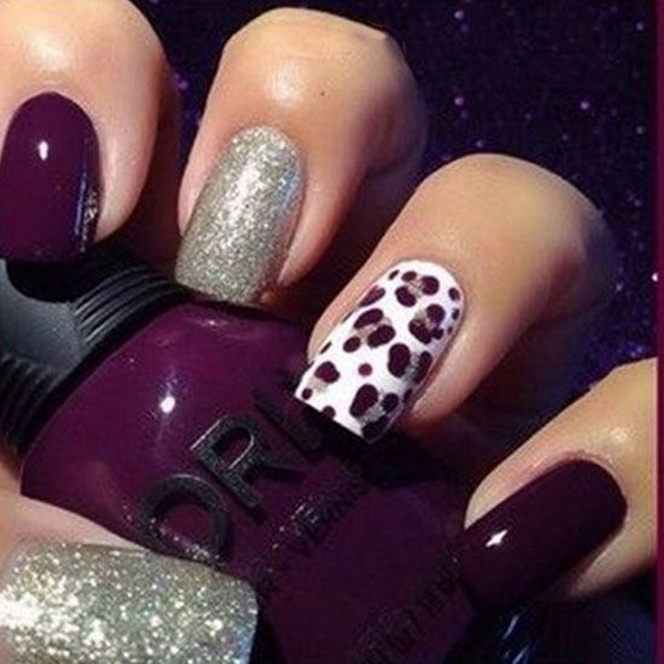 Dark purple and silver nail art with cheetah prints design.