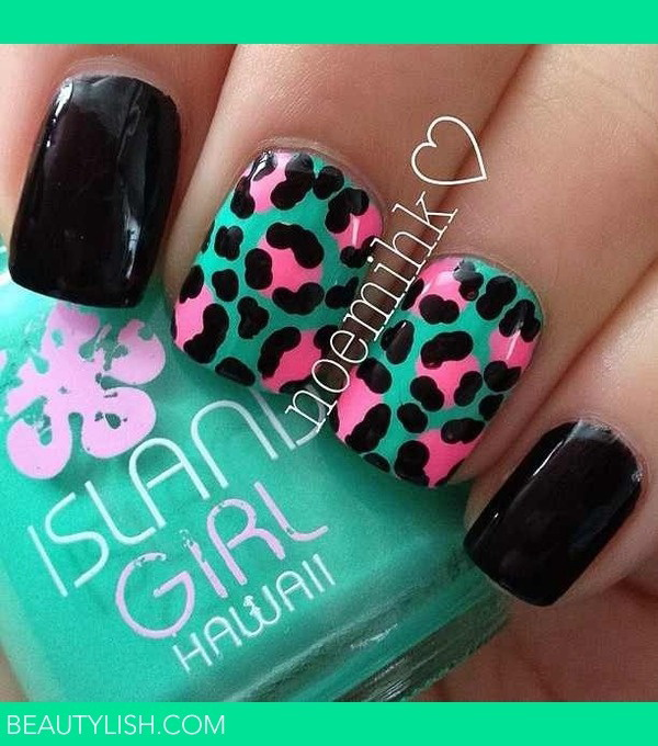 Turquoise base nail polish with black and pink animal prints design.