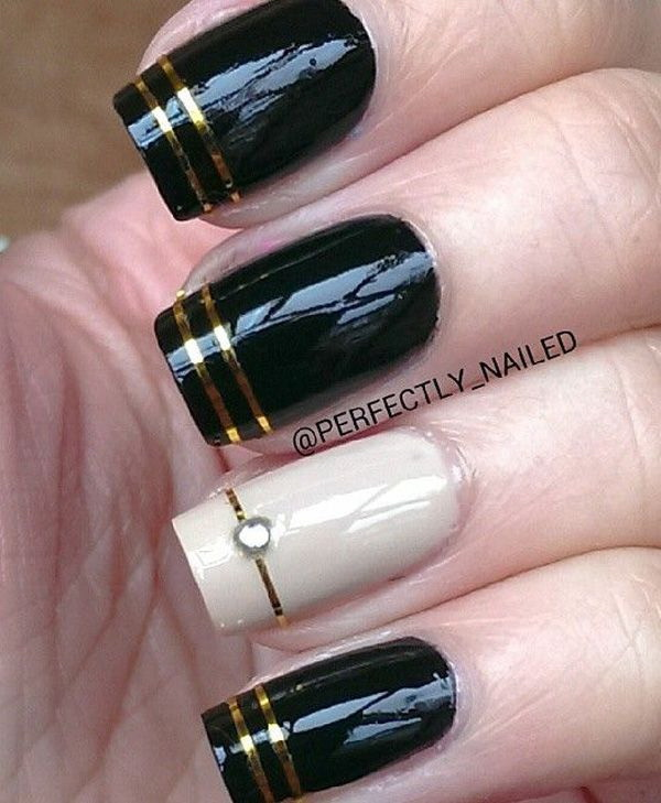 Black Nail Art Design With Gold Stripes For Detail