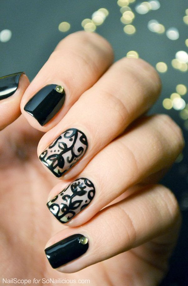Black Colored Floral Nails.