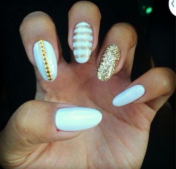 White And Gold Almond Nail Design with Gold Glitter Details.