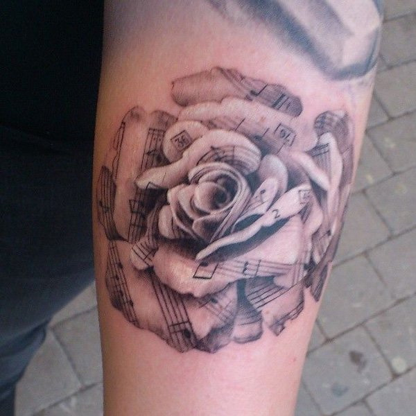 Sheet music rose Forearm Tattoo.What a cool tattoo design idea!  Love it very much! This will be my next tattoo design. via https://forcreativejuice.com/awesome-forearm-tattoo-designs/
