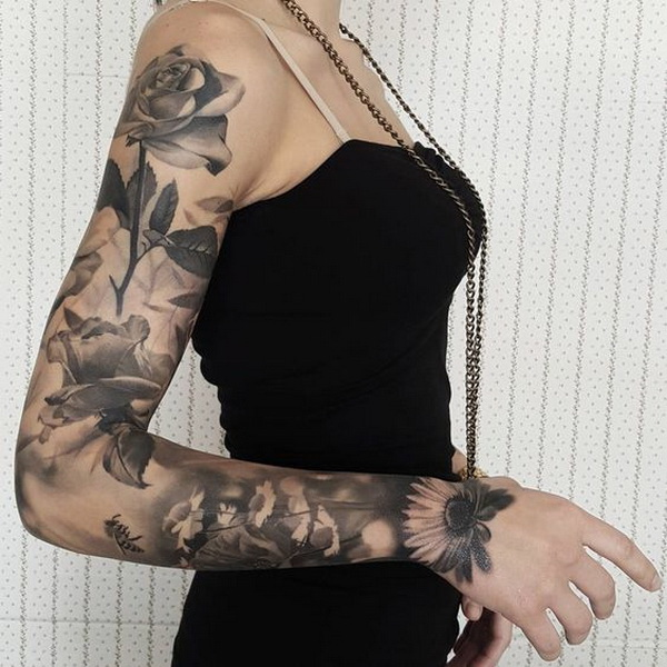 Floral Sleeve With Roses and Sunflowers. www. https://forcreativejuice.com/cool-sleeve-tattoo-designs/