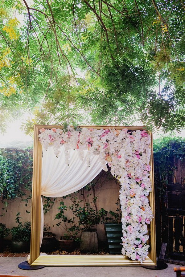 Golden Wedding Arch Draped With Florals.