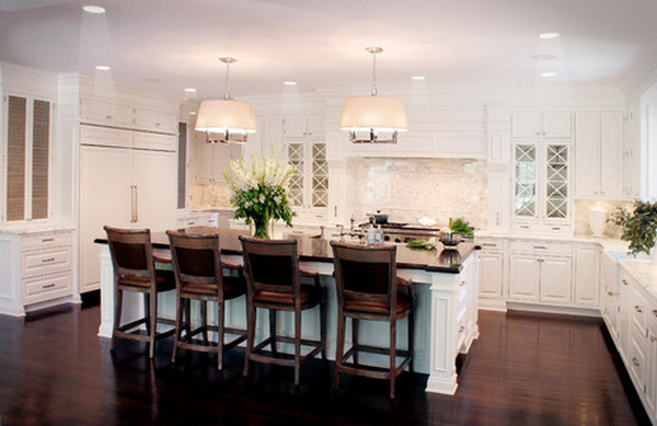 Traditional u-shaped white kitchen with wood countertops, raised-panel cabinets, white cabinets, stone slab backsplash, white backsplash and paneled appliances. More via http://forcreativejuice.com/elegant-white-kitchen-interior-designs/
